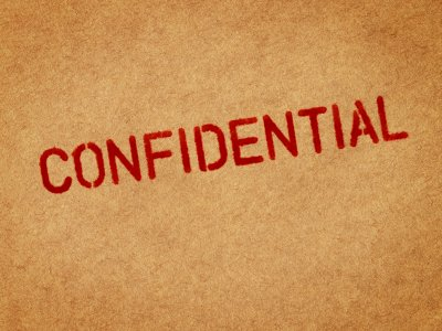 Confidential stamp on brown paper